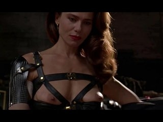Brunette Lena Olin in lingerie shows off her small tits